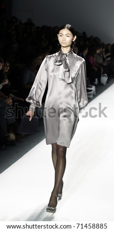 NEW YORK - FEBRUARY 17: A model walks the runway at the Elene Cassis Fall 2011 fashion show during Mercedes-Benz Fashion Week at The Studio at Lincoln Center on February 17, 2011 in New York City. - stock photo