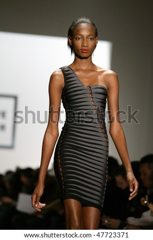 NEW YORK - FEBRUARY 14: A model walks the runway at the Herve Leger Collection for Fall/Winter 2010 during Mercedes Benz Fashion Week on February 14, 2010 in New York