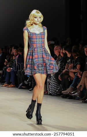 NEW YORK - FEBRUARY 13: A model walks the runway at the Mark & Estel Fall/Winter 2015 collection during Mercedes-Benz Fashion Week in New York on February 13, 2015.