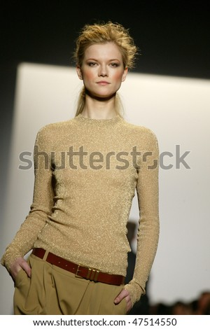 NEW YORK - FEBRUARY 17: A model walks the runway at the Michael Kors Collection for Fall/Winter 2010 during Fashion Week on February 17, 2010 in New York - stock photo