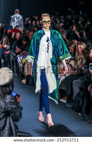 NEW YORK - FEBRUARY 13: A model walks the runway at the Mongol Fall/Winter 2015 collection during Mercedes-Benz Fashion Week in New York on February 13, 2015. - stock photo