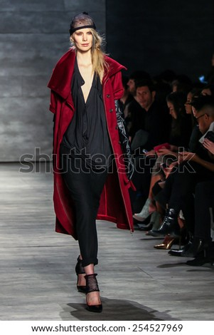 NEW YORK - FEBRUARY 12: A model walks the runway at the Nicholas K Fall/Winter 2015 collection during Mercedes-Benz Fashion Week in New York on February 12, 2015. - stock photo