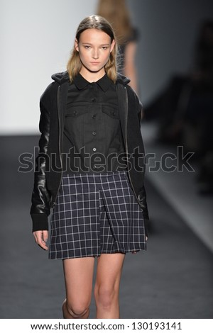 NEW YORK - FEBRUARY 07: A model walks the runway at the Timo Weiland Fall Winter 2013 Women's Collection during Mercedes-Benz Fashion Week on February 7, 2013 in New York City.