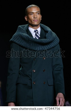 NEW YORK - FEBRUARY 18: A model walks the runway at the Tommy Hilfiger Collection for Fall/Winter 2010 during Fashion Week on February 18, 2010 in New York - stock photo