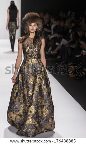 NEW YORK - FEBRUARY 11 2014: A model walks the runway during Badgley Mischka Fall 2014 fashion show at New York Mercedes - Benz Fashion Week - stock photo