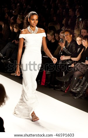 NEW YORK - FEBRUARY 12: A model walks the runway for the  Fashion for relief-Haiti   during Mercedes-Benz Fashion Week at Bryant Park on February 12, 2010 in New York.