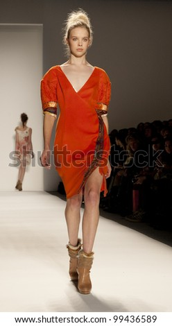NEW YORK - FEBRUARY 11: A model walks the runway in the Son Jung Wan Fall 2012 collection during Mercedes-Benz Fashion Week on February 11, 2012 in New York City. - stock photo