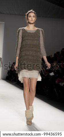 NEW YORK - FEBRUARY 11: A model walks the runway in the Son Jung Wan Fall 2012 collection during Mercedes-Benz Fashion Week on February 11, 2012 in New York City.