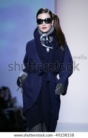 NEW YORK - FEBRUARY 16: A model walks the runway the Pamela Roland Collection for Fall/Winter 2010 during Mercedes-Benz Fashion Week on February 16, 2010 in New York. - stock photo