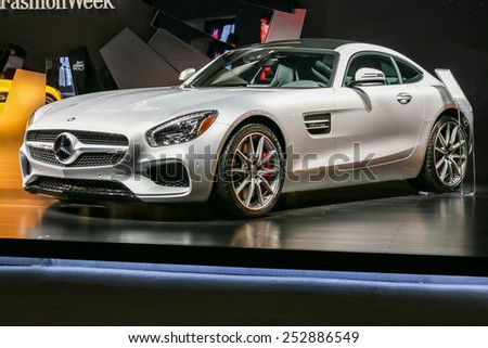 NEW YORK - FEBRUARY 14: A new 2016 Mercedes-AMG GT S shoving on Fall/Winter 2015 collection during Mercedes-Benz Fashion Week in New York on February 14, 2015. - stock photo