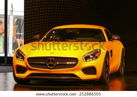 NEW YORK - FEBRUARY 14: A new 2016 Mercedes-AMG GT S shoving on   Mercedes-Benz Fashion Week in New York on February 14, 2015. - stock photo