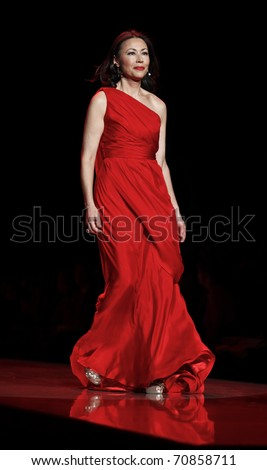 NEW YORK - FEBRUARY 09: Ann Curry in Carmen Marc Valvo dress walks runway for The Heart Truth's Red Dress Collection at Mercedes-Benz Fall/Winter 2011 Fashion Week on February 09, 2011 in New York