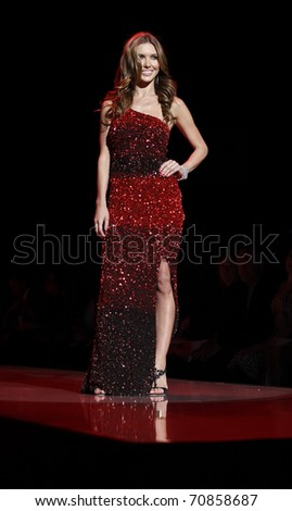 NEW YORK - FEBRUARY 09: Audrina Patridge in Badgley Mischka dress walks runway for The Heart Truth's Red Dress Collection at Mercedes-Benz Fall/Winter 2011 Fashion Week on February 09, 2011 in NYC