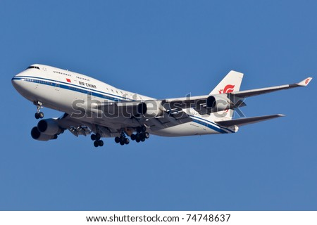 NEW YORK - FEBRUARY 10: Boeing 747-400 China Air approaches JFK airport located in New York, USA on February10, 2011 B747 called Jumbo Jet is most popular plane used in cargo and passenger transport