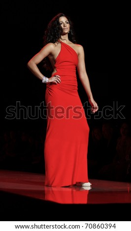 NEW YORK - FEBRUARY 09: Camila Alves in Kaufman Franco dress walks runway for The Heart Truth's Red Dress Collection at Mercedes-Benz Fall/Winter 2011 Fashion Week on February 09, 2011 in New York