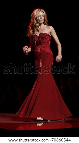NEW YORK - FEBRUARY 09: Cat Deeley in Alberta Ferretti dress walks runway for The Heart Truth's Red Dress Collection at Mercedes-Benz Fall/Winter 2011 Fashion Week on February 09, 2011 in New York
