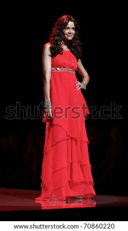 NEW YORK - FEBRUARY 09: Denise Richards in Matthew Williamson dress walks runway for The Heart Truth's Red Dress Collection at Mercedes-Benz Fall/Winter 2011 Fashion Week on February 09, 2011 in NYC