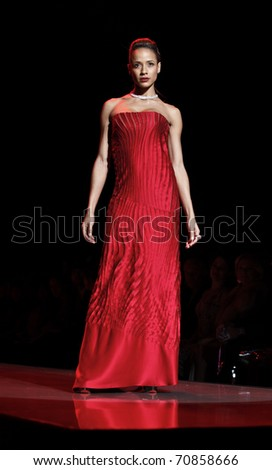 NEW YORK - FEBRUARY 09: Diana Ramirez in Catherine Malandrino dress walks runway for The Heart Truth's Red Dress Collection at Mercedes-Benz Fall/Winter 2011 Fashion Week on February 09, 2011 in NYC