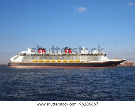NEW YORK - FEBRUARY 28: Disney Fantasy, a new cruise ship, enters New York Harbor for the first time, February 28, 2012. The 130,000-ton vessel is the 4th Disney Cruise Line ship. - stock photo