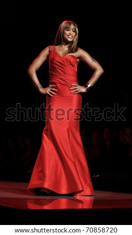 NEW YORK - FEBRUARY 09: Eve in David Meister dress walks runway for The Heart Truth's Red Dress Collection at Mercedes-Benz Fall/Winter 2011 Fashion Week on February 09, 2011 in New York City.