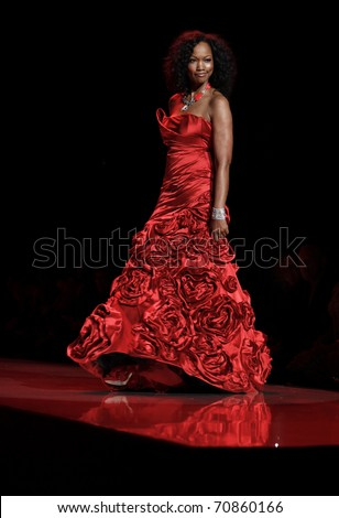 NEW YORK - FEBRUARY 09: Garcelle Beauvais in Monique Lhuillier dress walks runway for The Heart Truth's Red Dress Collection at Mercedes-Benz Fall/Winter 2011 Fashion Week on February 09, 2011 in NYC
