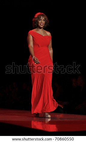 NEW YORK - FEBRUARY 09: Gayle King in Donna Karan dress walks runway for The Heart Truth's Red Dress Collection at Mercedes-Benz Fall/Winter 2011 Fashion Week on February 09, 2011 in New York City.