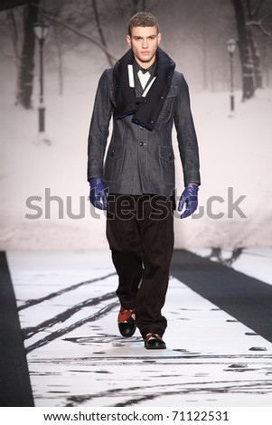 NEW YORK - FEBRUARY 12: Male model walks the runway at the G-STAR RAW Fall 2011 Collection presentation during Mercedes-Benz Fashion Week on February 12, 2011 in New York. - stock photo