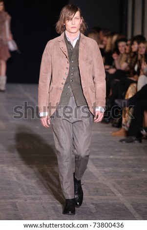 NEW YORK - FEBRUARY 15: Male model walks the wooden runway at the DIESEL BLACK GOLD Fall 2011 Collection presentation during Mercedes-Benz Fashion Week on February 15, 2011 in New York.