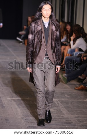 NEW YORK - FEBRUARY 15: Male model walks the wooden runway at the DIESEL BLACK GOLD Fall 2011 Collection presentation during Mercedes-Benz Fashion Week on February 15, 2011 in New York