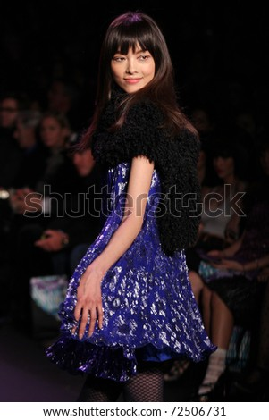 NEW YORK - FEBRUARY 16: Model Fei Fei Sun walks the runway at the Anna Sui Fall 2011 Collection presentation during Mercedes-Benz Fashion Week on February 16, 2011 in New York