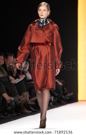 NEW YORK - FEBRUARY 14: Model Ieva Laguna walks the runway at the Carolina Herrera Fall 2011 Collection presentation during Mercedes-Benz Fashion Week on February 14, 2011 in New York. - stock photo