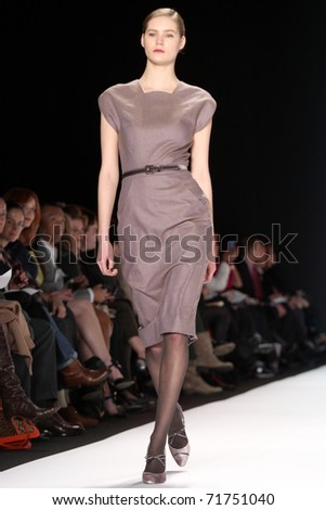 NEW YORK - FEBRUARY 14: Model Juju Ivanyuk walks the runway at the Carolina Herrera Fall 2011 Collection presentation during Mercedes-Benz Fashion Week on February 14, 2011 in New York. - stock photo