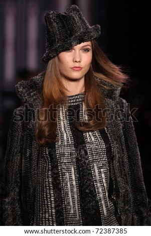 NEW YORK - FEBRUARY 16: Model Karlie Kloss walks the runway at the Anna Sui Fall 2011 Collection presentation during Mercedes-Benz Fashion Week on February 16, 2011 in New York.