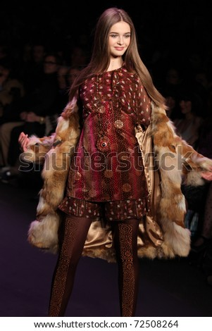 NEW YORK - FEBRUARY 16: Model Kristina Romanova walks the runway at the Anna Sui Fall 2011 Collection presentation during Mercedes-Benz Fashion Week on February 16, 2011 in New York.