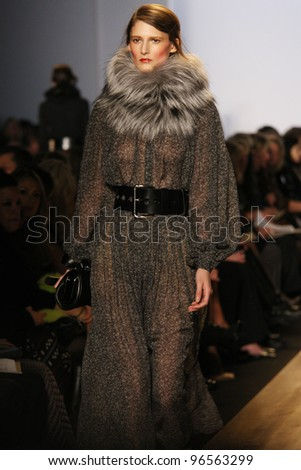 NEW YORK - FEBRUARY 15: Model Marie Piovesan walks the runway at the Michael Kors FW 2012 collection presentation during Mercedes-Benz Fashion Week on February 15, 2012 in New York.
