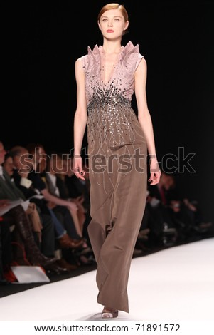 NEW YORK - FEBRUARY 14: Model Olga Sherer walks the runway at the Carolina Herrera Fall 2011 Collection presentation during Mercedes-Benz Fashion Week on February 14, 2011 in New York. - stock photo