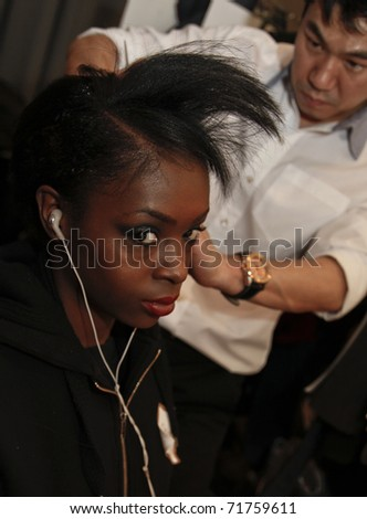 NEW YORK - FEBRUARY 15: Model prepares backstage for presentation at the Concept Korea Fall 2011 at Mercedes-Benz Fashion Week in David Rubenstein Atrium on February 15, 2011 in New York City