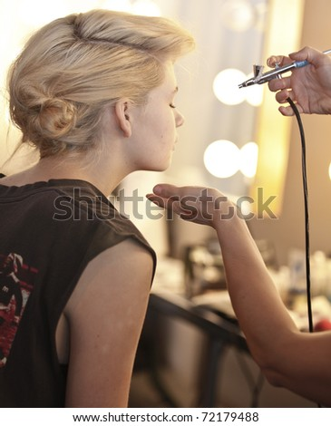 NEW YORK - FEBRUARY 11: Model prepares backstage for The Lake & Stars collection by Maayan Zilberman, Nikki Dekker at Mercedes-Benz Fall/Winter 2011 Fashion Week on February 11, 2011 in New York City. - stock photo