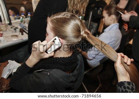 NEW YORK - FEBRUARY 13: Model prepares backstage for Yoana Baraschi collection presentation at Mercedes-Benz Fall/Winter 2011 Fashion Week on February 13, 2011 in New York City - stock photo