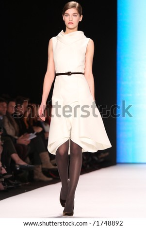 NEW YORK - FEBRUARY 14: Model Samantha Gradoville walks the runway at the Carolina Herrera Fall 2011 Collection presentation during Mercedes-Benz Fashion Week on February 14, 2011 in New York. - stock photo