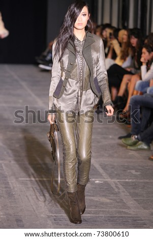 NEW YORK - FEBRUARY 15: Model Shu Pei Qin walks the wooden runway at the DIESEL BLACK GOLD Fall 2011 Collection presentation during Mercedes-Benz Fashion Week on February 15, 2011 in New York