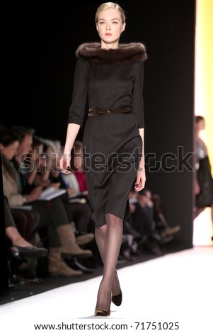 NEW YORK - FEBRUARY 14: Model Siri Toller�¸d walks the runway at the Carolina Herrera Fall 2011 Collection presentation during Mercedes-Benz Fashion Week on February 14, 2011 in New York.