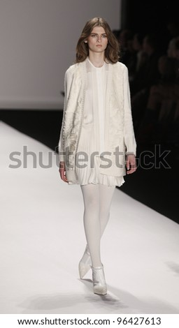 NEW YORK - FEBRUARY 15: Model walks on runway for J. Mendel collection by Gilles Mendel during Fashion week at Lincoln Center in Manhattan on February 15, 2012 in New York City