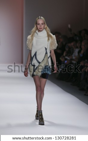 NEW YORK - FEBRUARY 10: Model walks runway during Fall 2013 presentation for Custo Barcelona collection by Custo Dalmau at Mercedes-Benz Fashion Week at Lincoln Center on February 10, 2013 in New York