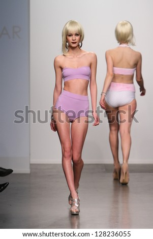 NEW YORK - FEBRUARY 13: Model walks runway for Dos Caras Swimwear collection at Pier 59 studios during Nolcha Fashion Week on February 13, 2013 in New York City - stock photo