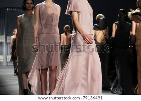 NEW YORK - FEBRUARY 15: Model walks the catwalk at the Vera Wang Fall 2011 Collection Presentation during Mercedes-Benz Fashion Week on February 15, 2011 in New York. - stock photo