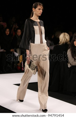 NEW YORK - FEBRUARY 9: Model walks the runway at the BCBG Max Azria SS 2012 Collection presentation during Mercedes-Benz Fashion Week on February 9, 2012 in New York.