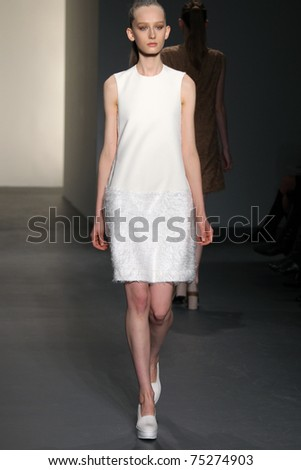 NEW YORK - FEBRUARY 17: Model walks the runway at the Calvin Klein Fall 2011 Collection presentation during Mercedes-Benz Fashion Week on February 17, 2011 in New York. - stock photo