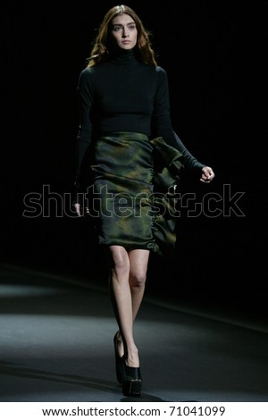 NEW YORK - FEBRUARY 10: Model walks the runway at the Christian Siriano Fall 2011 Collection presentation during Mercedes-Benz Fashion Week on February 10, 2011 in New York. - stock photo
