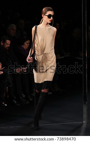NEW YORK - FEBRUARY 13: Model walks the runway at the  Diane Von Furstenberg Fall 2011 Collection by Yvan Mispelaere  during Mercedes-Benz Fashion Week on February 13, 2011 in New York. - stock photo